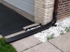 Downspout extension over sidewalk